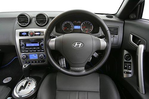 Hyundai describe the dash on the Tiburon as cockpit style
