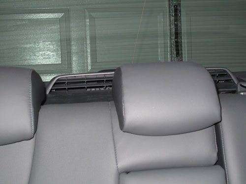 The rear parcel shelf is taken up with this rather large vent ... below the vent is the battery.