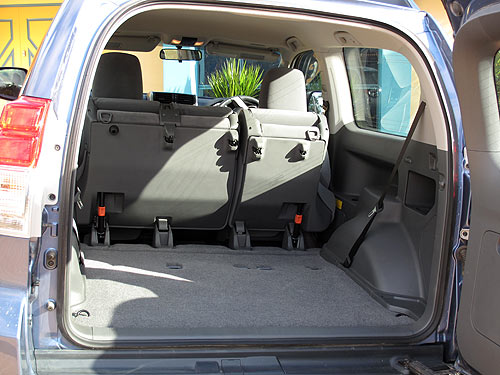 Luggage space in the Toyota Prado 3-door with the rear seats folded forward.