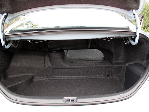 The boot of the Toyota Hybrid Camry with the rear seat folded down