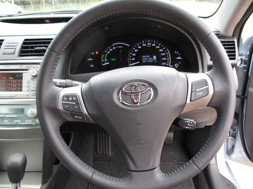 The cruise control can be seen at about 4 o'clock to the Toyota logo on the steering wheel