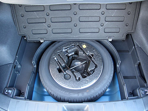 There's lots of storage space for small items around the spare tyre