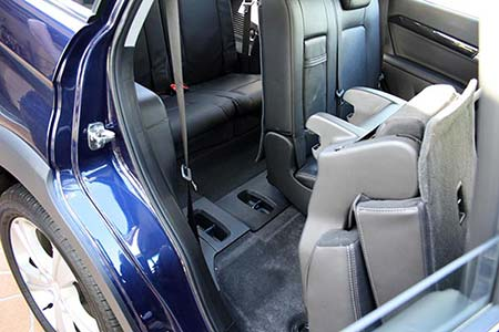 Climbing into the third row of seats in the Series II Holden Captiva 7